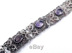Bracelet ancien en argent massif ajouré orné d'améthystes époque XIXeme
