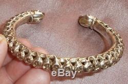 Bracelet torque ethnique ancien en argent massif ajouré & têtes d'animaux